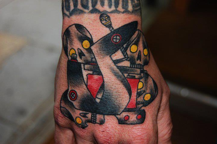 Robo Sculls Wrist tattoo by Marked For Life