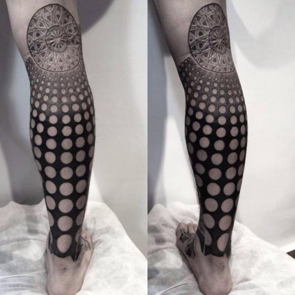 Round Holes Blackwork tattoo by Chopstick Tattoo on Leg