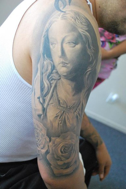 Saint Virgin Mary Chicano tattoo on Shoulder