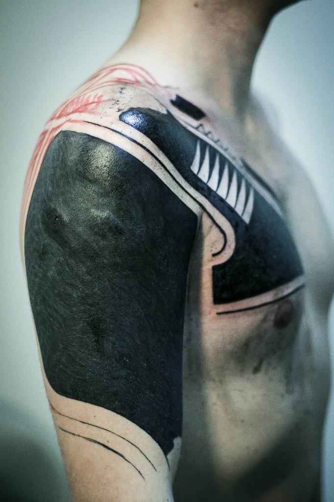Shoulder Blackwork tattoo for men