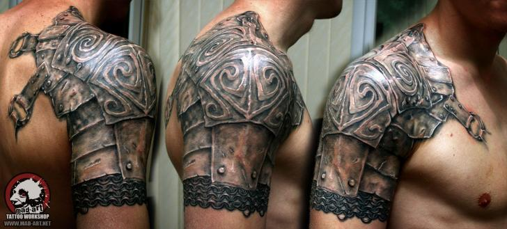 Metal Armor tattoo on shoulder