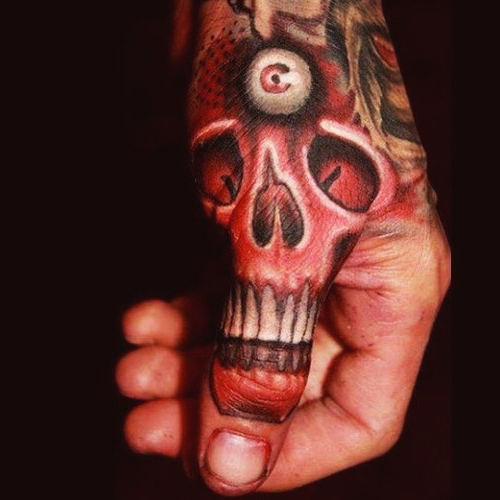 Third Eye Scull New School tattoo on Thumb