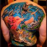 Tiger and Dragon Fight tattoo by Chapel tattoo