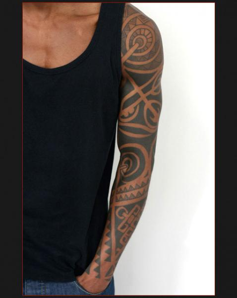 Tribal tattoo sleeve by Chapel tattoo