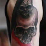 Twin Cracked Skull Trash Polka tattoo