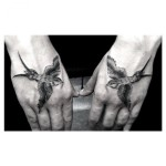 Two Identical Swallows Graphic tattoo by Dr Woo on Hands