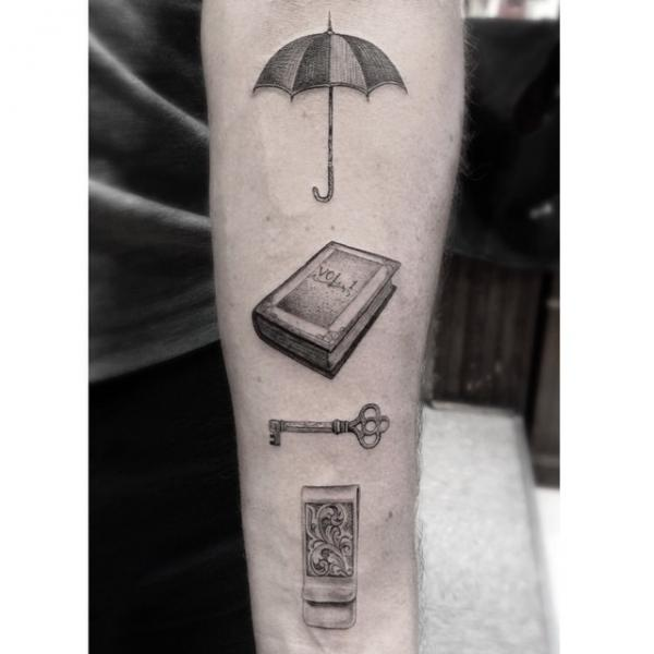 Umbrella Book and Key Graphic tattoo by Dr Woo