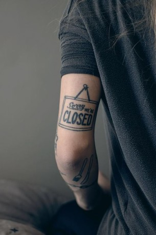 Sorry We're Closed Lettering Arm tattoo