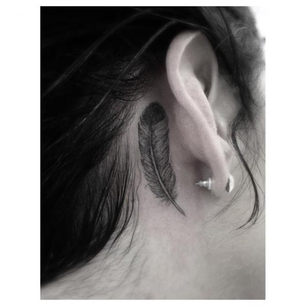 Cool Fether tattoo behind Ear by Dr Woo