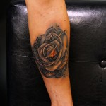 Amazing Metal Rose tattoo by Andres Acosta