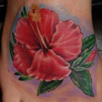 Amazing Realistic Red Flower tattoo by Tantrix Body Art