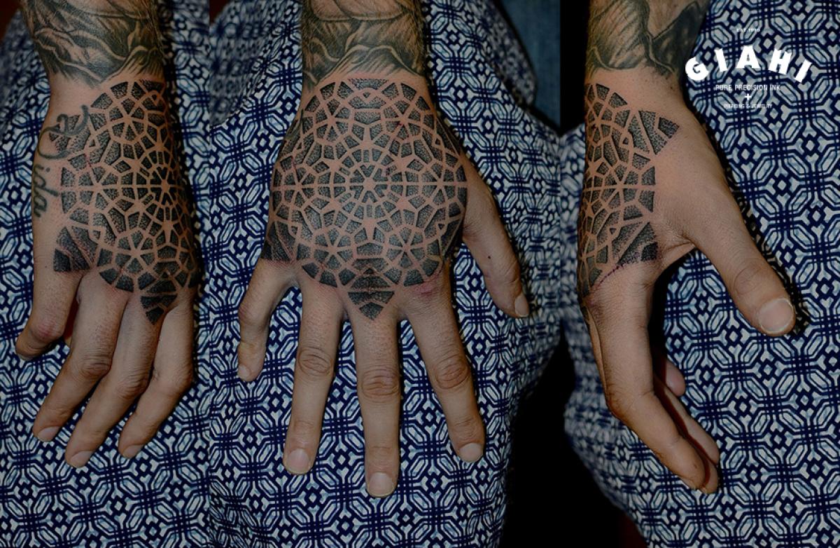 Back of Hand Dotwork Kaleidoscope tattoo by Andy Cryztalz