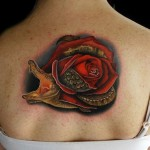 Back of Neck Allirose Alligator Rose and Alligator tattoo by Andres Acosta