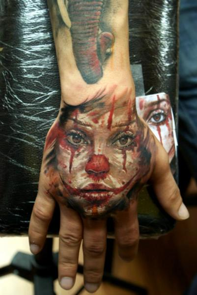 Back of The Hand Clown Girl tattoo by Bloodlines Gallery