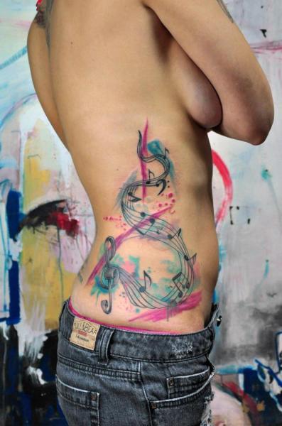 Bass and Treble Clef Aquarelle tattoo by Galata Tattoo
