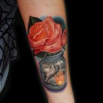 Beauty After Storm Rose in Can tattoo by Andres Acosta