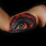 Biceps Space Eye realistic tattoo by Andres Acosta