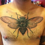 Big Fly on Chest Blackwork tattoo by Three Kings Tattoo