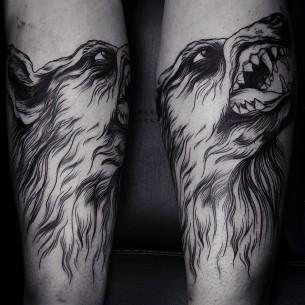 Big Teeth Angry Wolf Blackwork tattoo by Dmitriy Zakharov