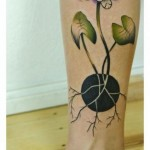 Black and White Roots Flower tattoo by Julia Rehme
