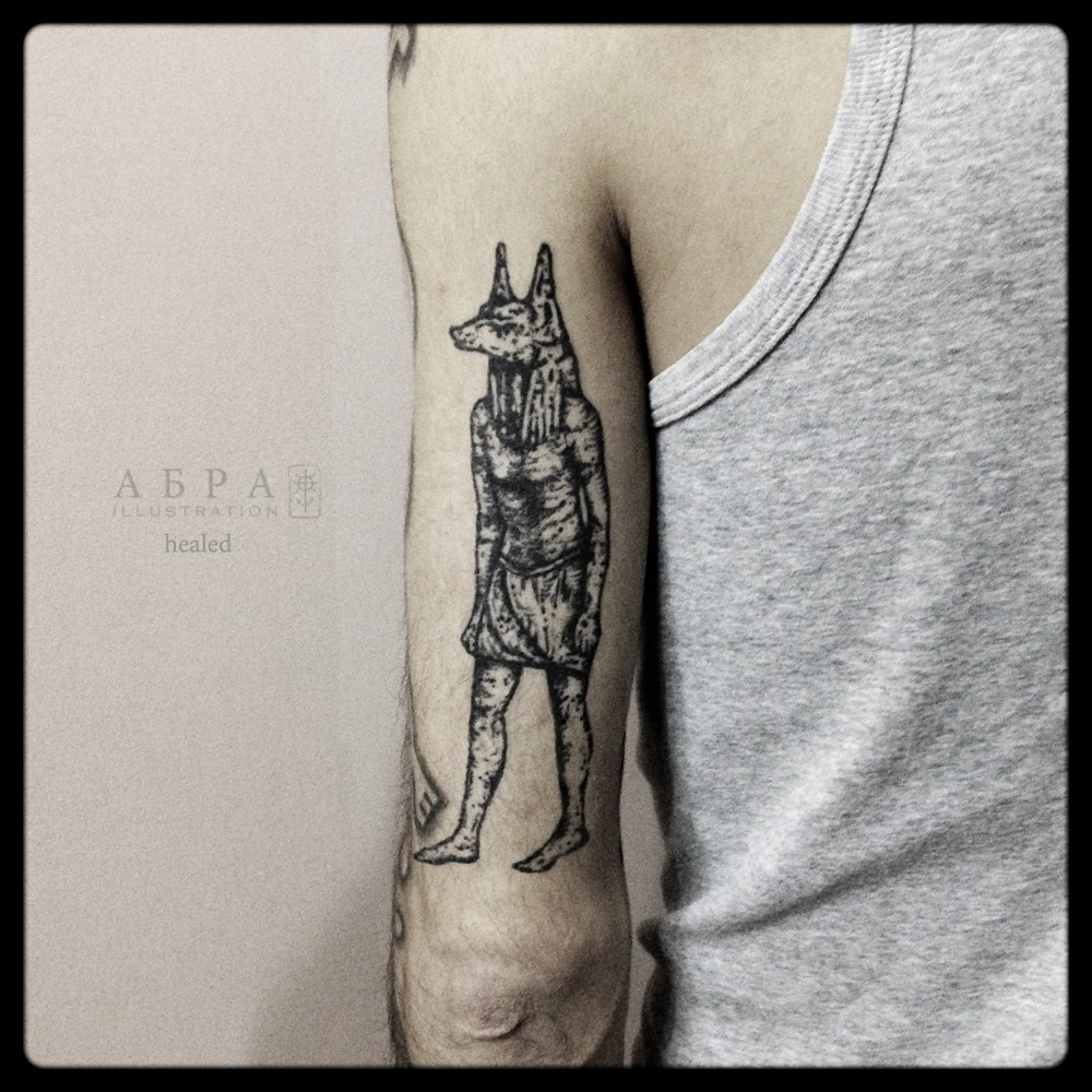 Blackwork Anubis tattoo by Abra Black