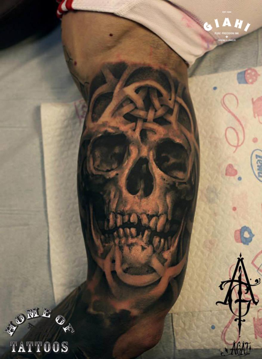 Blackwork Biceps Skull tattoo by Agat Artemji