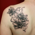 Blade Graphic Flowers tattoo by Skin Deep Art