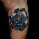 Blue Grey Glowing Rose tattoo by Andres Acosta