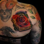 Brown Pages Rose Book tattoo by Andres Acosta
