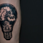 Candle and Skull Inside Bulb Blackwork tattoo