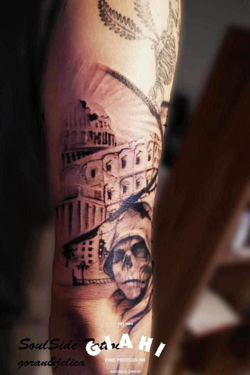 Capitol Skull in Hood Gaphic tattoo by Goran Petrovic