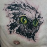 Cat Eyes Look Through Skin Skull tattoo by Skin Deep Art