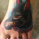 Chained Wolf Foot Old School tattoo by Elda Bernardes