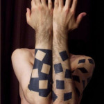 Contrast Missing Squares Blackwork tattoo