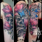 Cracked Butterfly Flowers Skull tattoo by Agat Artemji