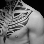 Ethnic Chest and Neck Blackwork tattoo