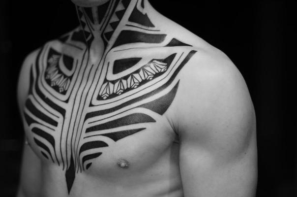 Ethnic Chest and Neck Blackwork tattoo