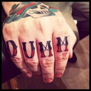 Finger DUMM Lettering tattoo by Sarah B Bolen