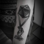 Hand and Earth Dotwork tattoo by Ien Levin