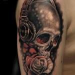 Headphones Rose and Skull tattoo by Mumia Tattoo