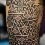 Hexahedrons and Triangles Dotwork tattoo by Andy Cryztalz