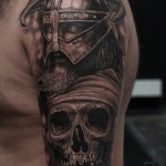 Horn Helmet Warrior and Skull tattoo by Mumia Tattoo