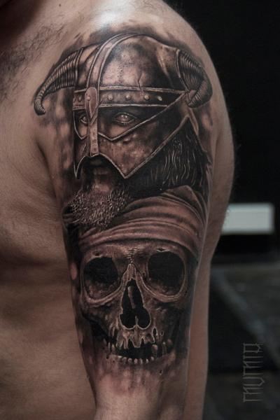 Horn Helmet Warrior and Scull tattoo by Mumia Tattoo