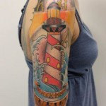 Lighthouse tattoo by Tantrix Body Art on Shoulder