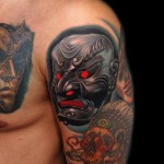 Metal Samurai Mask tattoo by Andres Acosta on Shoulder