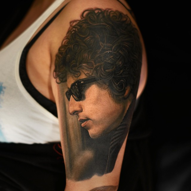 Realistic Bob Dylan tattoo by Nikko Hurtado