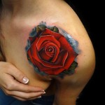 Red Shoulder Rose tattoo by Andres Acosta