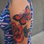 Rose and Butterfly tattoo by Robert Samuel
