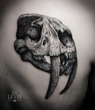 Saber Teeth Skull tattoo by Ien Levin