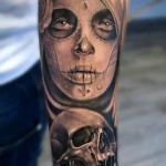 Sad Look Chicano Girl and Skull tattoo by Mumia Tattoo